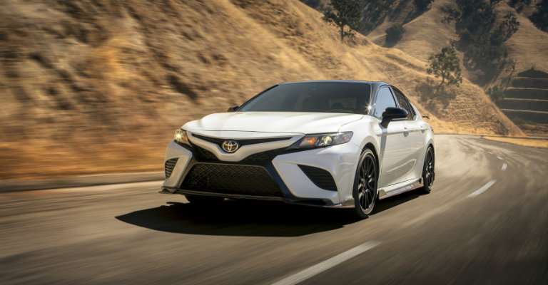 front-view-of-white-2020-Toyota-Camry-TRD-driving