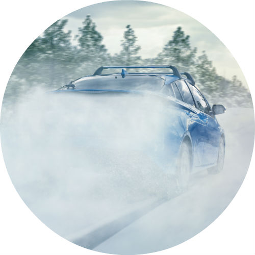 rear-view-of-blue-2019-Toyota-Prius-driving-through-snow