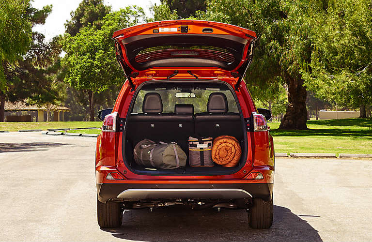 rear view of open cargo area of Toyota RAV4 packed with cargo