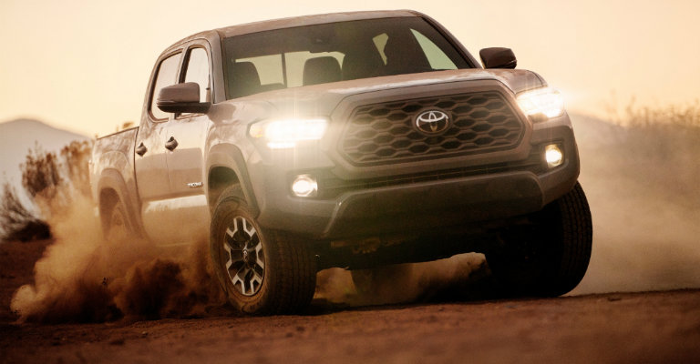 front-view-of-2020-Toyota-Tacoma-TRD-Off-Road-driving-through-sand