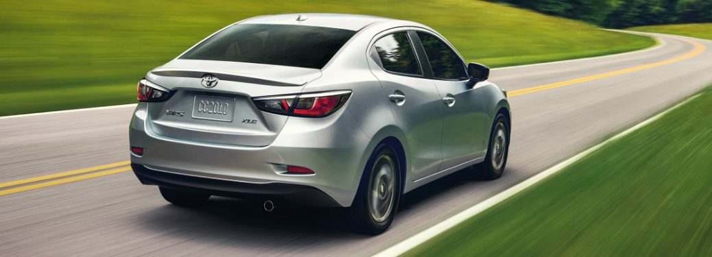 Silver 2019 Toyota Yaris Sedan driving on a curvy road