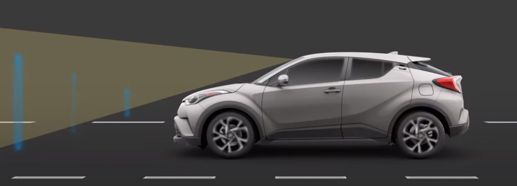 Grey Toyota C-HR in demostrtion of the Pre-Collision System