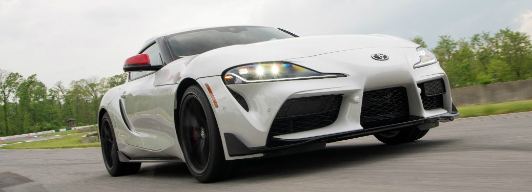 White 2020 Toyota GR Supra driving on a racetrack