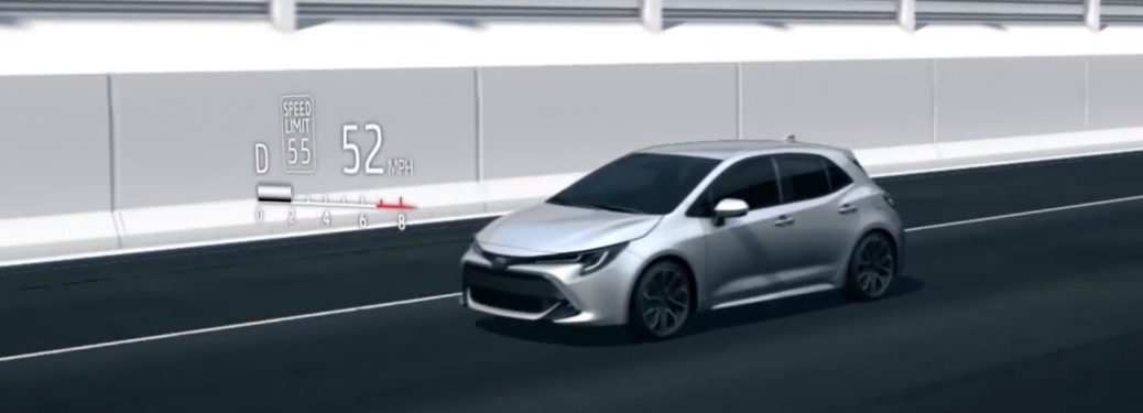 Demonstration of Toyota Road Sign Assist with a silver Toyota Corolla Hatchback