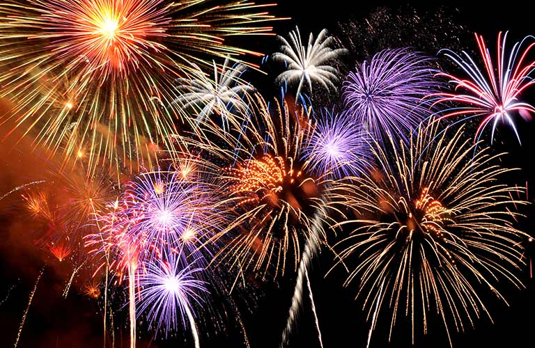 Many colorful fireworks exploding in the sky