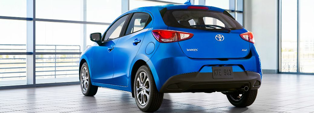 Rear view of blue 2020 Toyota Yaris Hatchback