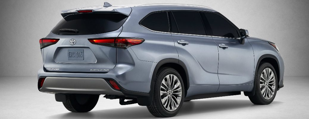 Passenger's side rear angle view of blue-grey 2020 Toyota Highlander
