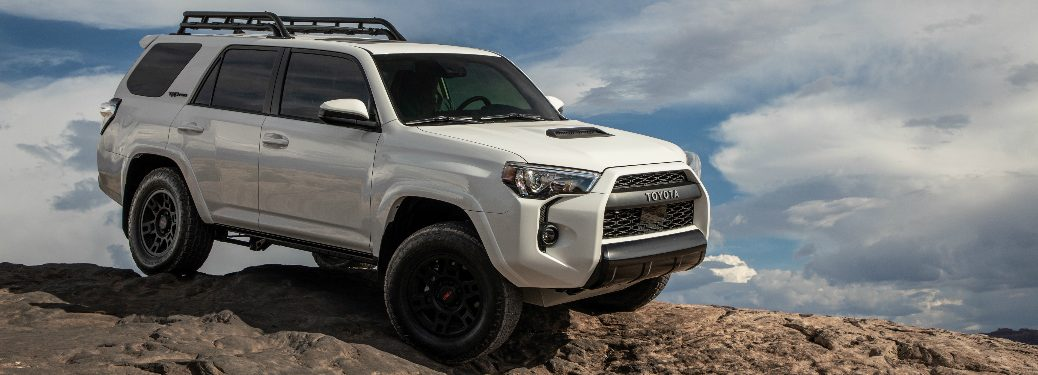 White 2020 Toyota 4Runner parked on a rocky hill