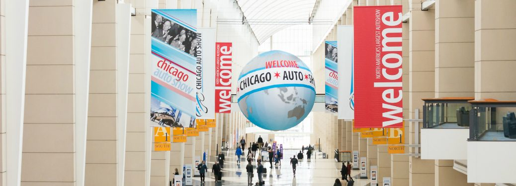 Banners and globe at the Chicago Auto Show