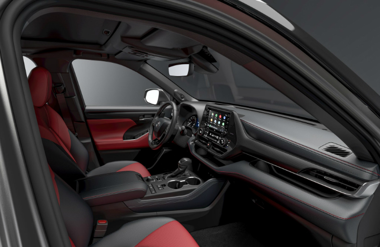 Grey and red dashboard and front seats in 2021 Toyota Highlander XSE