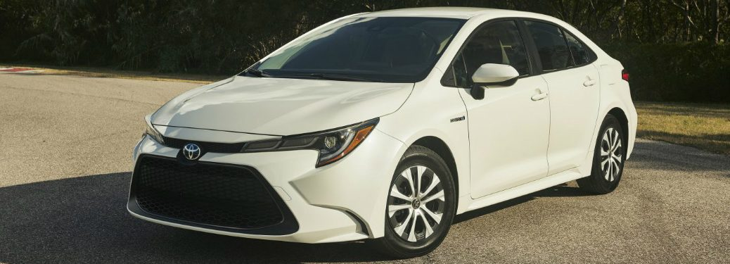 Driver's side front angle view of white 2020 Toyota Corolla Hybrid