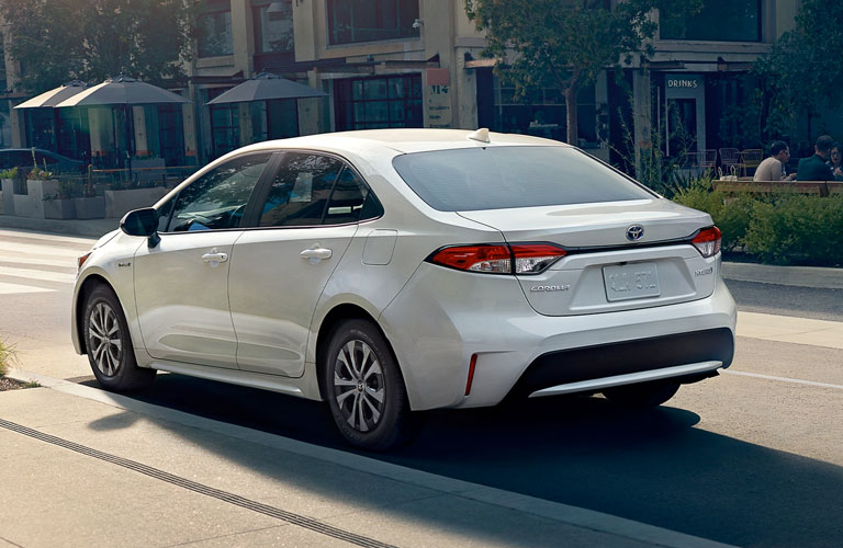 Driver's side rear angle view of white 2020 Toyota Corolla Hybrid