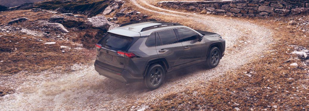Dark grey 2020 Toyota RAV4 driving on a mountainous road