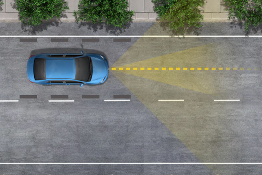 Graphic of a blue Toyota vehicle with a demonstration of the Lane Tracing Assist feature