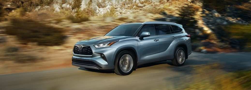 Blue-grey 2020 Toyota Highlander driving on a mountain road