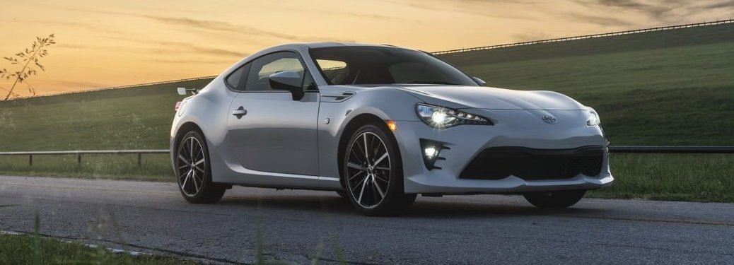 White 2020 Toyota 86 parked next to a grassy field