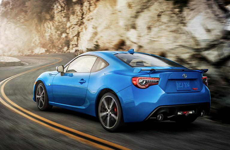 Blue 2020 Toyota 86 driving on a mountain road