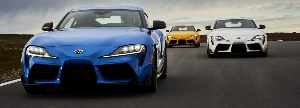 Blue, white, and yellow versions of the 2021 Toyota GR Supra