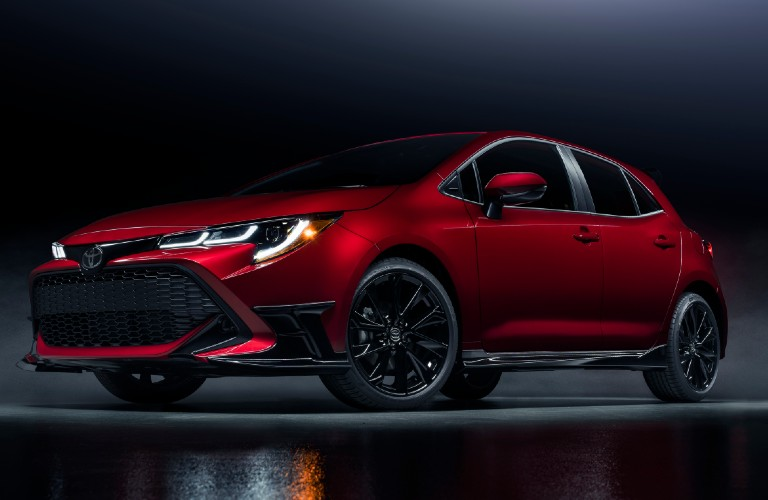 Driver's side front angle view of red 2021 Toyota Corolla Hatchback Special Edition