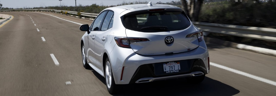 Driver's side rear angle view of silver 2021 Toyota Corolla Hatchback