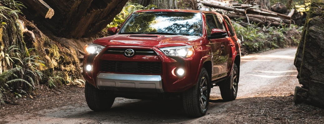 Red 2021 Toyota 4Runner driving through a forest