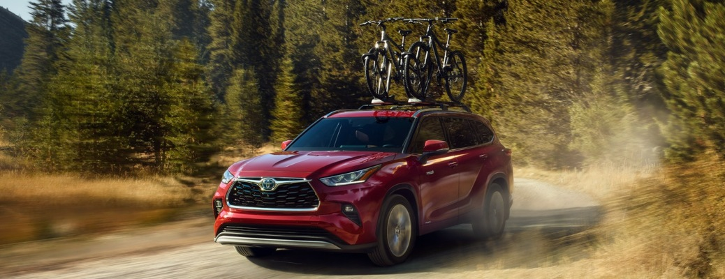 2021 Toyota Highlander red front view in dirt
