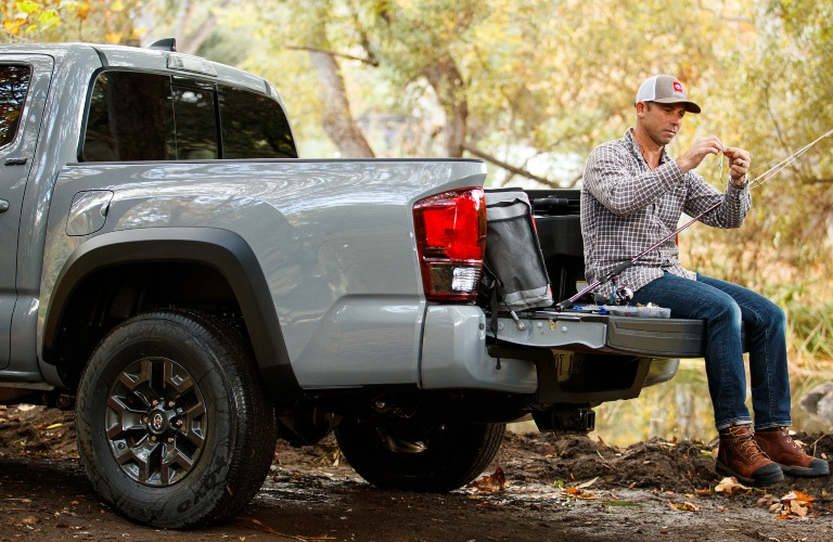 2021 Toyota Tacoma bed with man seating on tailgate
