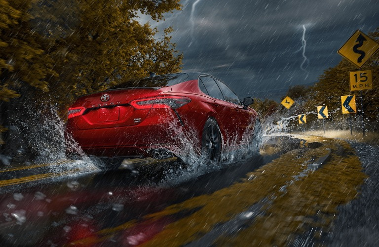 2021 Toyota Camry red back view in the rain