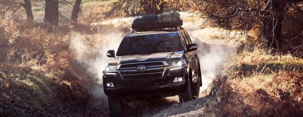2020 Toyota Land Cruiser black front view on an off-road trail