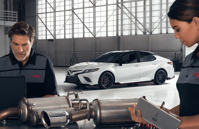 2021 Toyota Camry TRD white in a shop