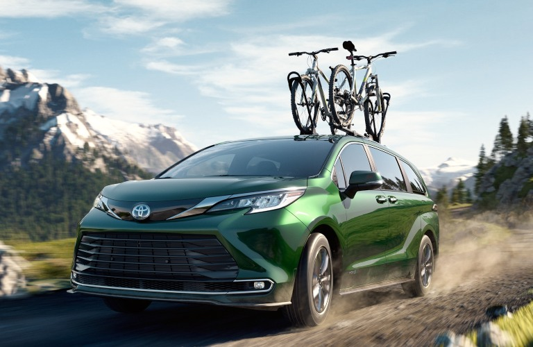2021 Toyota Sienna green front view with bikes