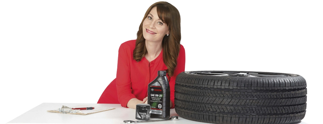 Woman standing behind a table of Toyota parts