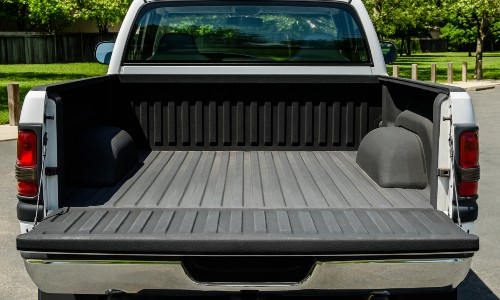 tailgate down on white truck bed