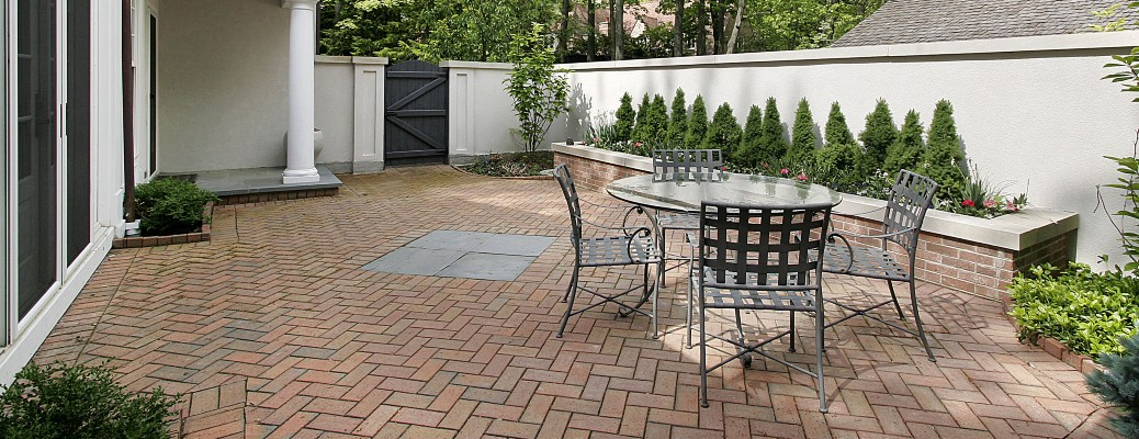 patio furniture on brick patio behind house