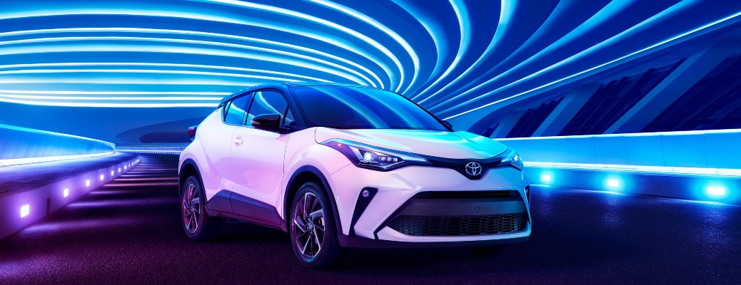 2021 Toyota C-HR white under blue lights with purple light accents