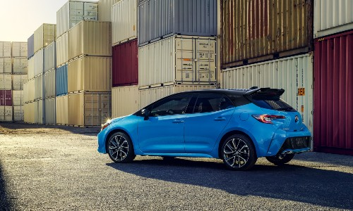 2021 Toyota Corolla Hatchback blue by shipping containers