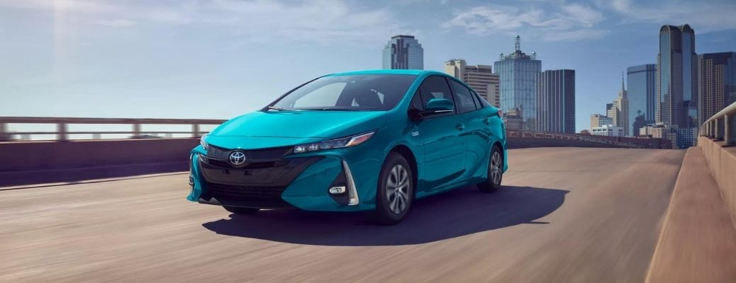 2022 Toyota Prius Prime Blue Magnetism moving on the road