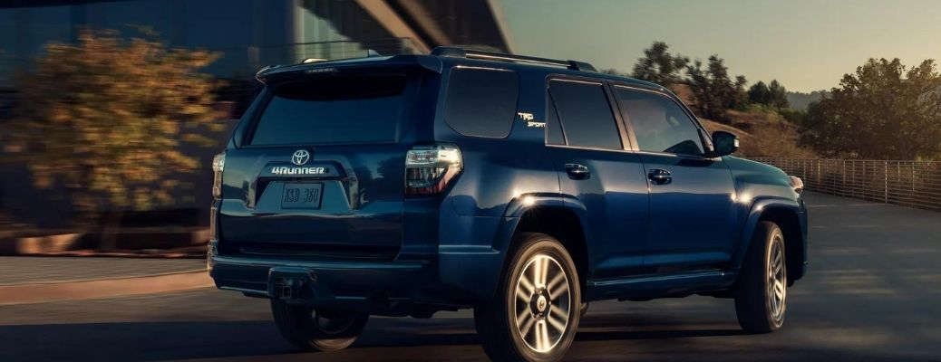 Back view of the 2021 Toyota 4Runner Nautical Blue Metallic parked outside a building