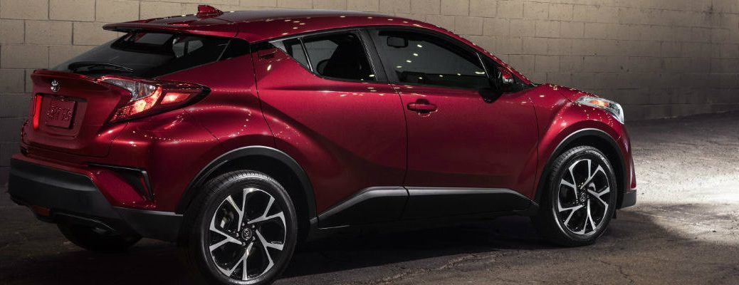 2018 Toyota C-HR parked next to a cinder block wall