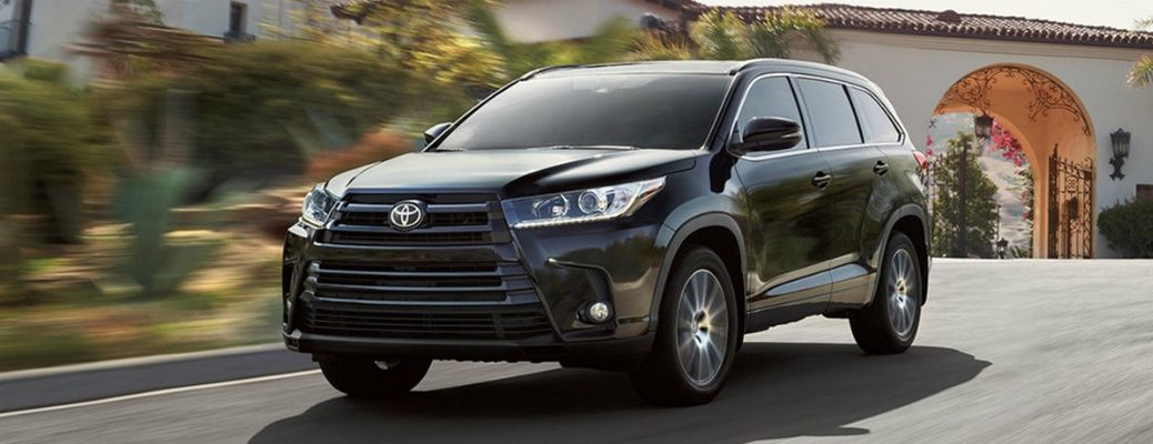2018 Toyota Highlander driving down the road