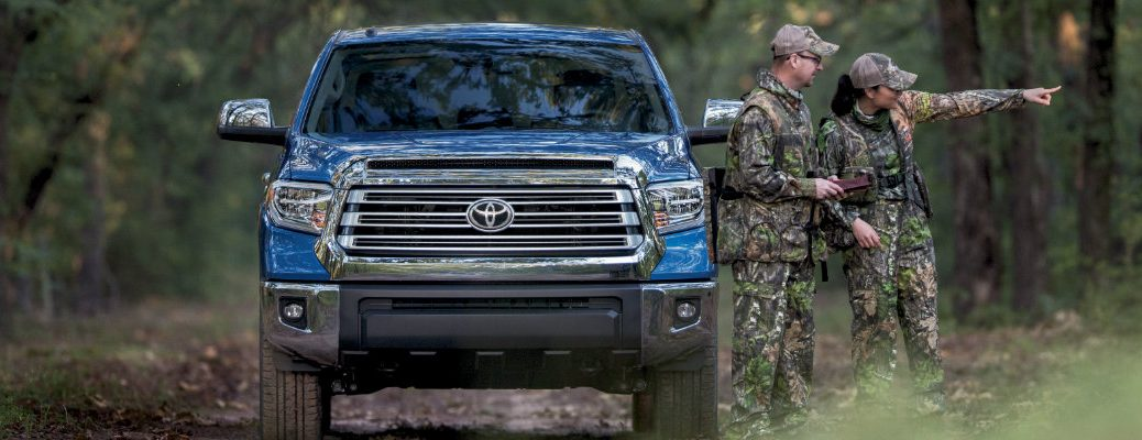 A man and a woman next to the 2018 Toyota Tundra