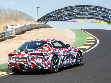 2019 Toyota Supra driving away on the race track