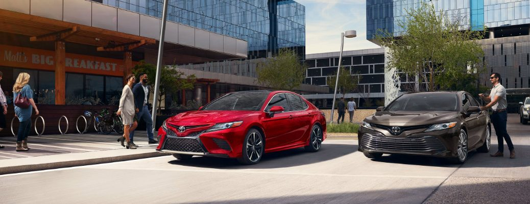 2019 Toyota Camry models in front of a building