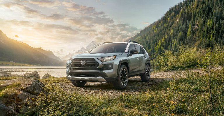 2019 Toyota RAV4 by a lake and mountains