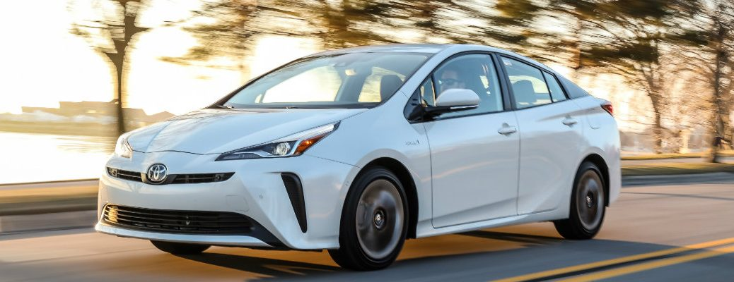 2019 Toyota Prius driving on a sunny day