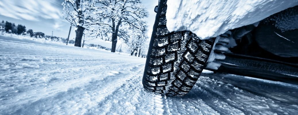 Car tires on a snow-covered road