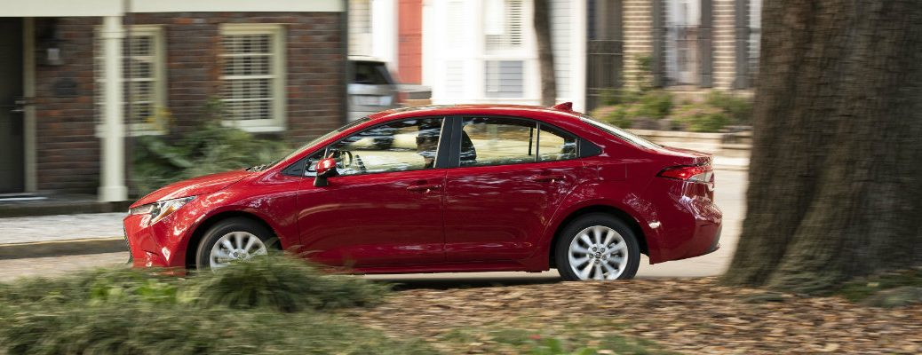 2020 Toyota Corolla LE driving past a house
