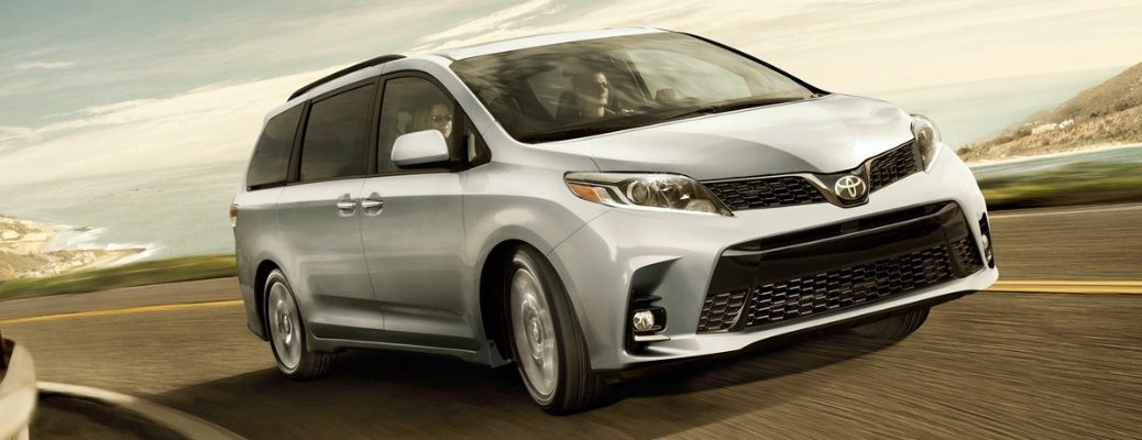 2019 Toyota Sienna driving fast on a sunny day