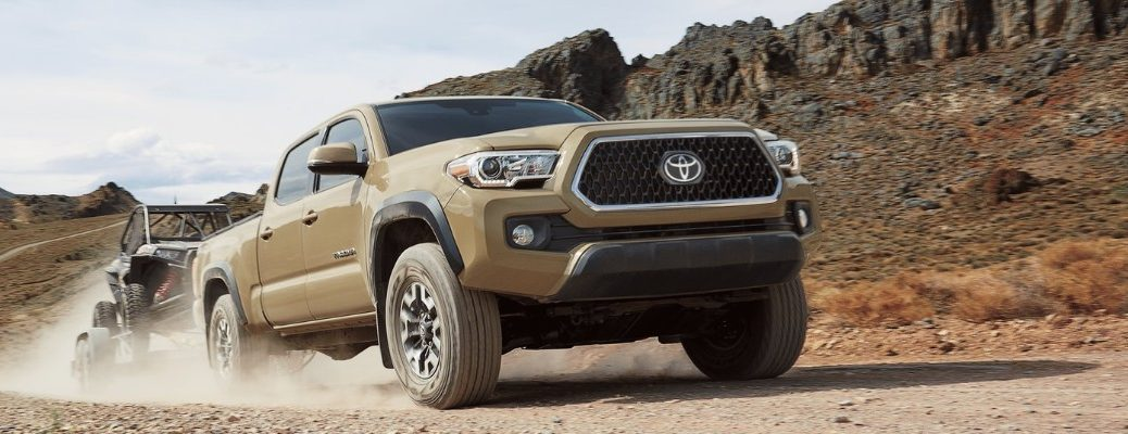 2019 Toyota Tacoma driving over a dirt hill