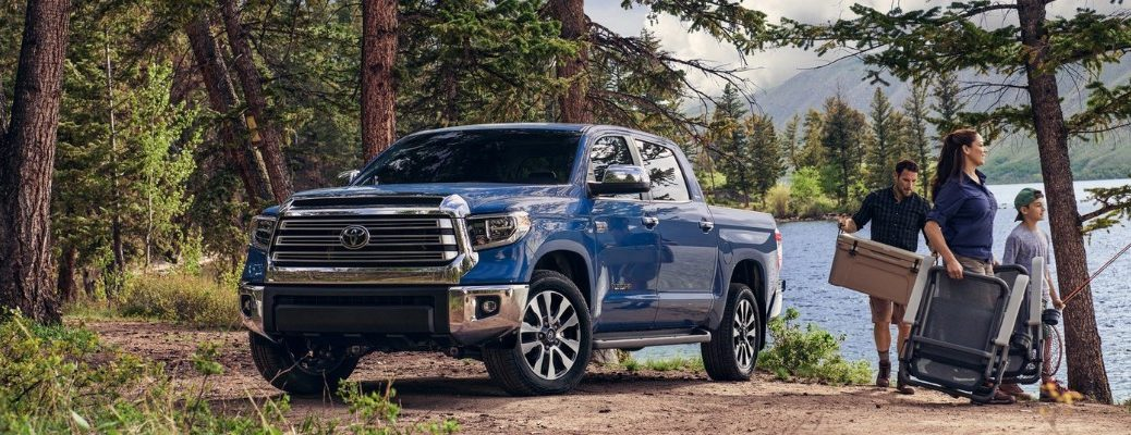 2020 Toyota Tundra with a family in the woods by the lake